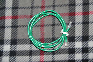 TWO SETS OF GREEN COMPUTER CABLES
