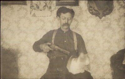 Unusual - Man Eyeglasses Moustache Gun at Cat's Head c1910 Real Photo Postcard - Gunslinger Mustache