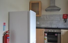 First Floor 2 bedroom Flat unfurnished with free parking - available asap long term