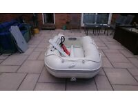 INFLATABLE DINGHY AND OUTBOARD MOTOR