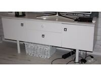 Retro style solid dressing cabinet without mirror, painted white, used as a tv cabinet.