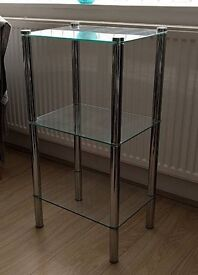 A glass 3tier shelving unit