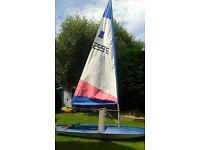 Blue topper dinghy sailing boat