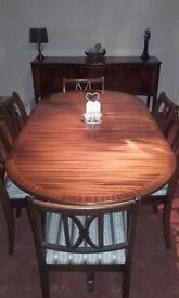 Dining table and 6 chairs, sideboard and glass display cabinate.