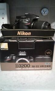 Nikon Camera + 2 Lenses + Backpack