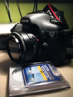 Canon 7D body+Canon EF50mm,f1.8+extra LP-E6 battery