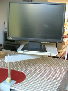 Very strong solid rotating metal table, for screen. Phone or any