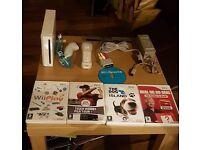 Nintendo Wii Bundle ☆5 Games☆4 GB SD Card☆1 Pad and 1 Nunchacku☆