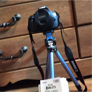 Canon Rebel T5 with 3 year warranty and tripod