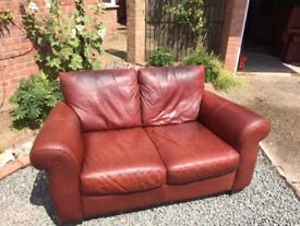 Brown leather love seat and two armchairs for sale.