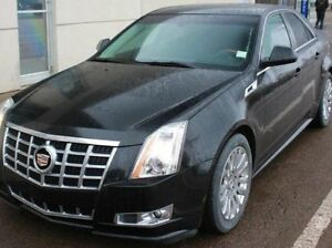 Looking for a white or black used Cadillac CTS