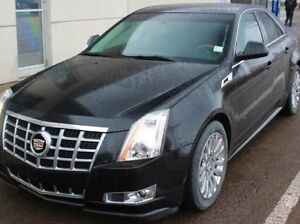 Looking for a used black or white Cadillac CTS