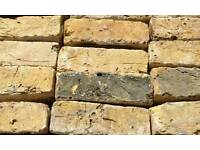 Yellow and red reclaimed bricks for sale.