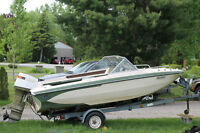 16 foot glasstron bow rider 65 hp w/trailer 1500.00 firm