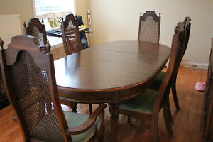 Solid Oak dining table with 6 chairs and matching Buffet