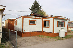 An amazing opportunity to own or rent a double size mobile home.