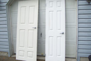 TWO SOLID WOOD DOORS BOTH INTERIOR DOORS COVERED IN WHITE VYNAL