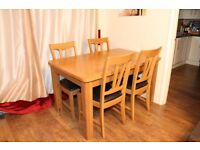 Solid Oak extending dining room table and four chairs, great condition