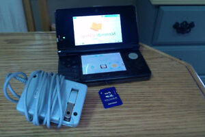Used Nintendo 3DS - Great condition. With charger AND SD card