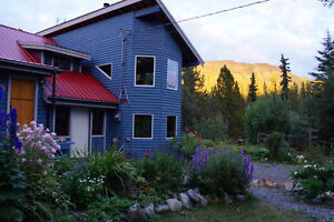 CREEKSIDE HAVEN ON 1.6 ACRES - ATLIN!  PG ID # 143765