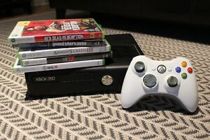 Xbox 360 Slim - 4 GB with Controller and 5 Games