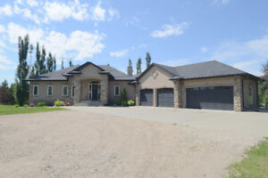 EXECUTIVE BUNGALOW ON ACREAGE LOT IS WITHIN CITY LIMITS.