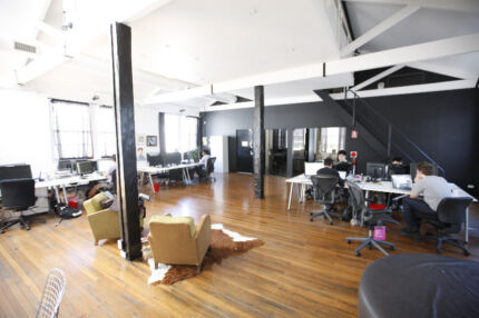 Co-working shared desk space in creative office in Surry Hills