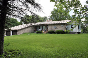 Nestled Back In The Trees On 40 Acres, Sits A Raised Bungalow