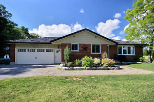 Completely renovated 3 + 1 bedroom Bungalow in Country setting.