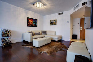 Beautiful Renovated Condo in High End Building