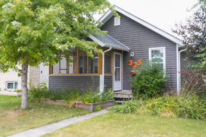 Solid Bungalow with Heated Garage (w/ Workshop) + Man Cave