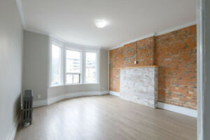 Newly Renovated 2 bed Suite with Exposed Brick & Balcony