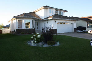 Save $200,000 on beautiful custom built house in Tofield