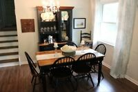 Table with six chairs and china cabinet