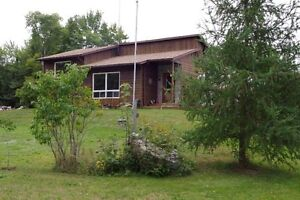 HOME AND SHOP ON 19 MUSKOKA ACRES. LOW PRICE, HUGE OPPORTUNITY
