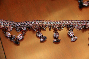 Beaded decorative trim in brown with teal accent.