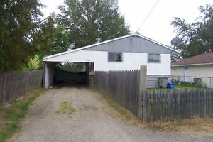 Investor Alert! House with good roof and private yard for sale.