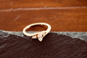 14k Yellow gold lady's ring with marquis diamond