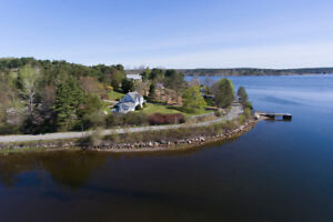Situated on over 2 acres of paradise in beautiful Maders Cove