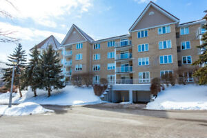 Welcome To This Bright & Cheery Unit In Rivermill Condos!!