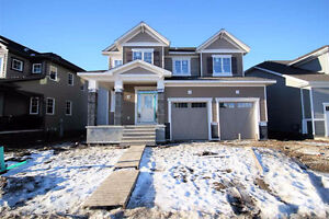Stunning home, like showhome, backing Golf Course - come see