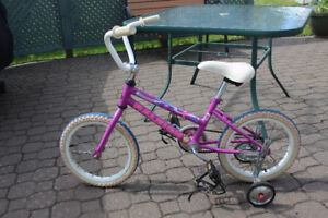 Girls Raleigh Bike, comes with foot straps and training wheels.