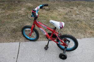 "Supercylce 14"" BMX with training wheels."