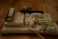Wii + Wii FIT + Wii Sports + 2 manettes + nunchuk (non-négo)