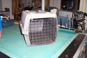Cage de transport pour chien ou chat.