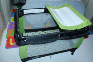 Playpen for sale (Evenflo) - travel-size, includes change mat
