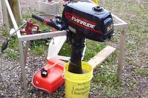 EVINRUDE 5HP . RUNS GREAT. NOT USED MUCH.