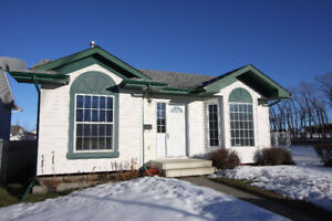 Lovely Innisfail Bungalow w/ Fenced and Hedged Yard Next to Park