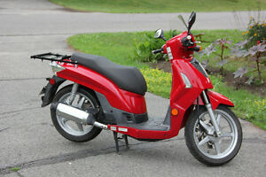 2009 Red Kymco Scooter