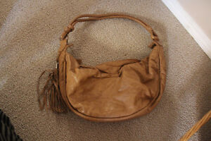 gently used beige faux leather purse